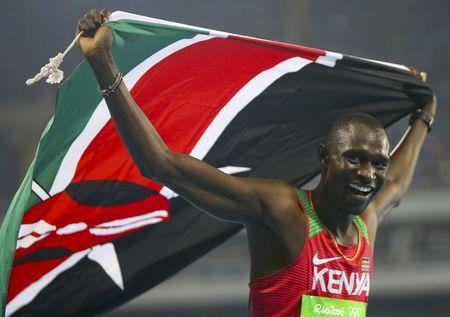 2016 Rio Olympics - Athletics - Final - Men's 800m Final - Olympic Stadium - Rio de Janeiro, Brazil - 15/08/2016. Gold medallist David Lekuta Rudisha (KEN) of Kenya celebrates with flag.  REUTERS/Leonhard Foeger