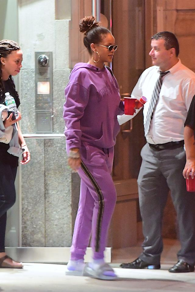 <p>In a purple hoodie and sweatpants, lavender socks, gray fur slides, hoop earrings, and sunglasses while out in New York. </p>
