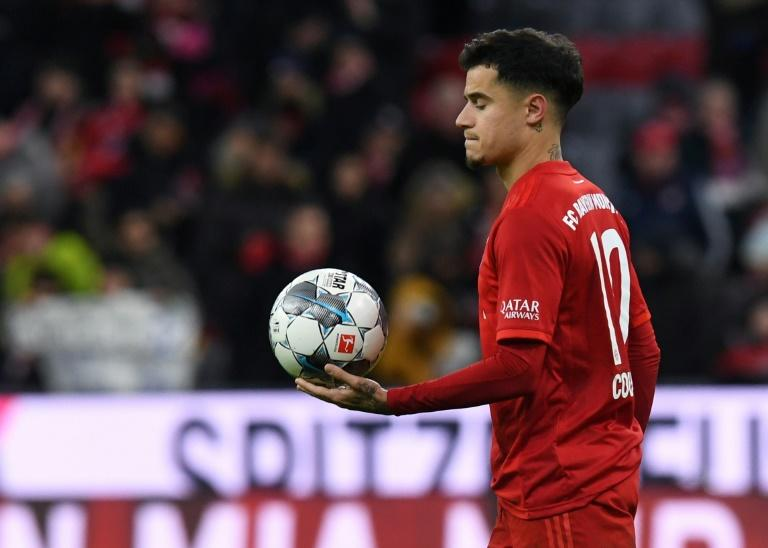 Philippe Coutinho walks off with the match ball after his hat-trick against Werder Bremen