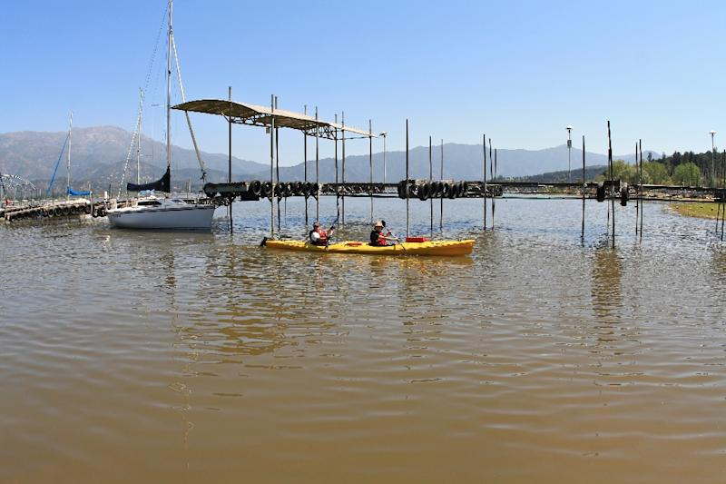 The Aculeo Lake, for decades one of the main tourist attractions of Santiago's surroundings, has disappeared due to a drought and overconsumption of water (AFP Photo/CHRISTIAN MIRANDA)