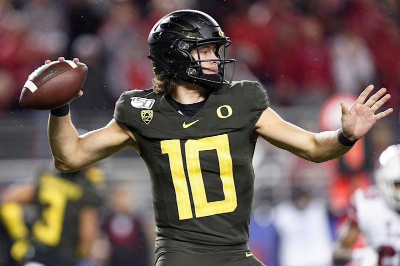 Oregon quarterback Justin Herbert throws a pass against Utah during the Pac-12 Conference championship game on Dec. 6.