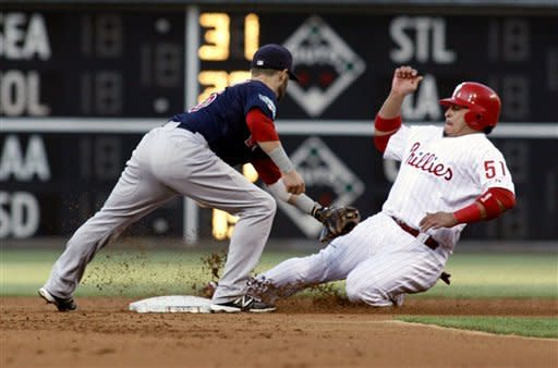 Boston Red Sox Dustin Pedroia, left moves for a late tag as Philadelphia Phillies' Carlos Ruiz steals second in the first inning of a baseball game on Friday, May 18, 2012, in Philadelphia. (AP Photo/H. Rumph Jr)