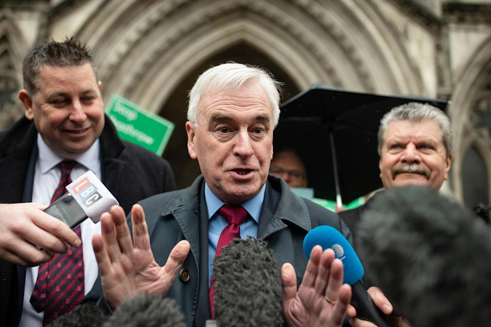 LONDON, ENGLAND - FEBRUARY 27: Shadow Chancellor John McDonnell talks to the media as he stands with fellow campaigners outside the Royal Courts of Justice following the announcement ruling against the controversial third runway for Heathrow airport on February 27, 2020 in London, England.  Critics of the plans took the case to the court of appeal, claiming that the developments did not take into account climate change commitments. (Photo by Leon Neal/Getty Images)
