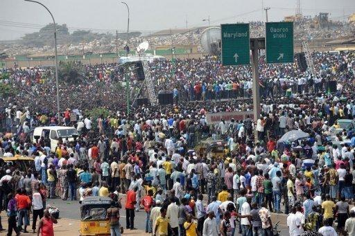 Thousands of fuel protesters gather at Gani Fawehinmi Park in Lagos. Tens of thousands of protesting Nigerians defied an order to end a three-day-old strike Wednesday as unions threatened oil production and a mob rampaged in one city, leaving a police officer dead
