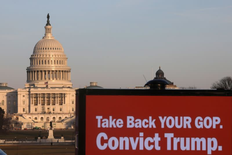 Trucks advertising in support of convicting former U.S President Donald Trump in his upcoming second impeachment trial are seen parked on the National Mall with the U.S. Capitol Building visible behind them in Washington