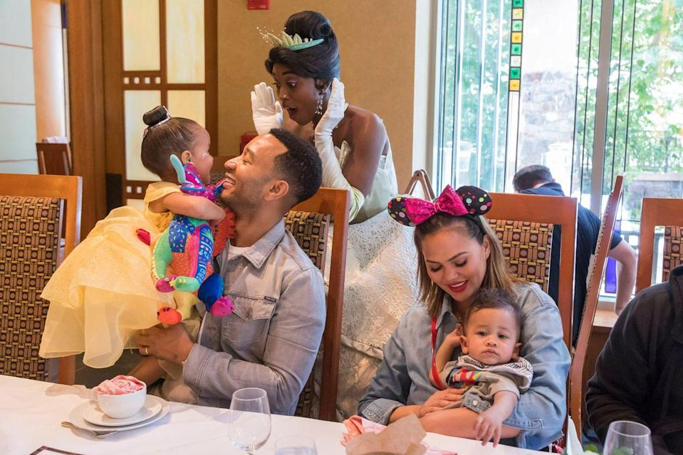 <p>The couple took their children, including a very excited Luna, to visit princesses (like Princess Tiana, pictured here) at Disneyland in California.</p>