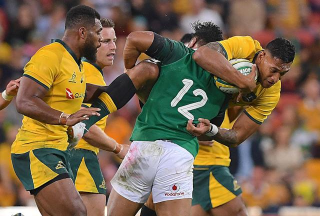 Rugby Union - June Internationals - Australia vs Ireland - Lang Park, Brisbane, Australia - June 9, 2018 - Israel Folau of Australia is tackled by Bundee Aki of Ireland. AAP/Dave Hunt/via REUTERS ATTENTION EDITORS - THIS IMAGE WAS PROVIDED BY A THIRD PARTY. NO RESALES. NO ARCHIVE. AUSTRALIA OUT. NEW ZEALAND OUT.