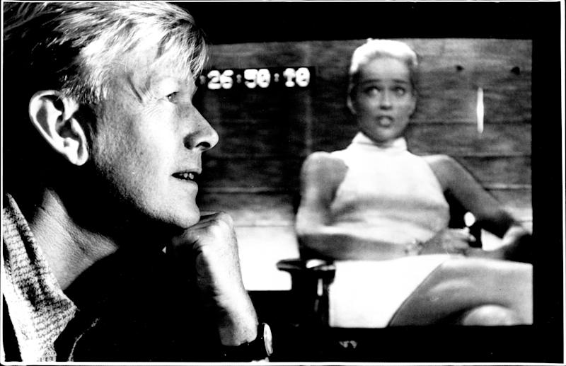 Censor for Channel Nine Richard Lyle with basic instincts Sharon Stone.Viewers watching television on Sunday night wondering what the Anglo-Saxon profanity was going on - and what might next get snipped - were in a huge majority in Sydney.The 9 pm screening of the Michael Douglas-Sharon Stone film Basic Instinct - a big hit on the night - was a first attempt by Channel 9 under new mature audience (MA) classifications to hold back the prime-time start of a cinema R-rated movie for the 30 minutes needed to comply with Government guidelines. April 11, 1994. (Photo by Steve Christo/Fairfax Media via Getty Images).