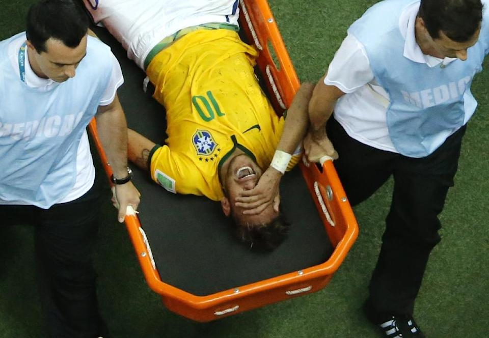 Neymar left the 2014 World Cup quarter-final between Brazil and Colombia on a stretcher and was ruled out of the rest of the tournament with a back injury (AFP Photo/FABRIZIO BENSCH)