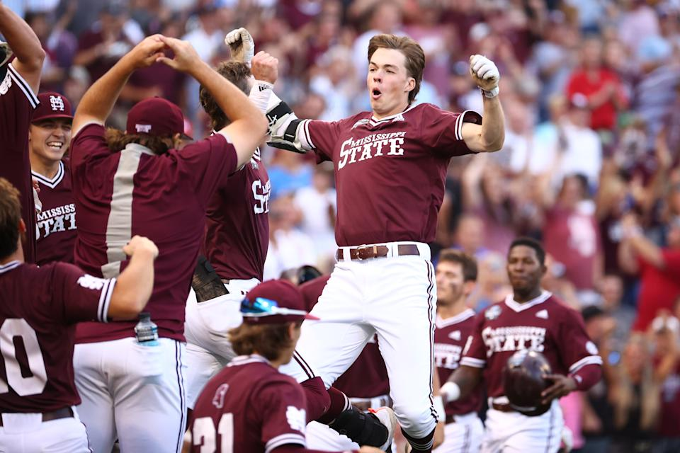 OMAHA, NE - JUNE 30: Kellum Clark #11 of the Mississippi St. Bulldogs celebrates with teammates after hitting a three-run home run against the Vanderbilt Commodores  during the seventh inning during the Division I Men's Baseball Championship held at TD Ameritrade Park Omaha on June 30, 2021 in Omaha, Nebraska. (Photo by Justin Tafoya/NCAA Photos via Getty Images)