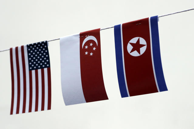 <p>The American, Singaporean and North Korean flags decorate the entrance of a local bar on Thursday, June 7, 2018, in Singapore. (Photo: Wong Maye-E/AP) </p>