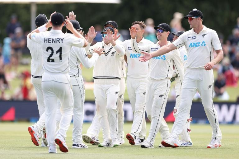 New Zealand players celebrate the victory which saw them attain the world's top Test team ranking