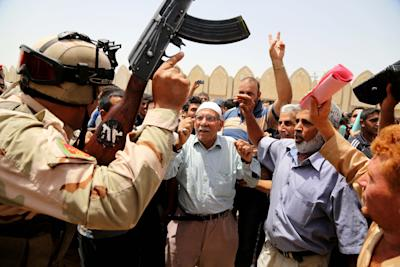 CLICK IMAGE for slideshow: Al-Qaida-inspired insurgents gaining ground in Iraq. (AP Photo/ Karim Kadim)