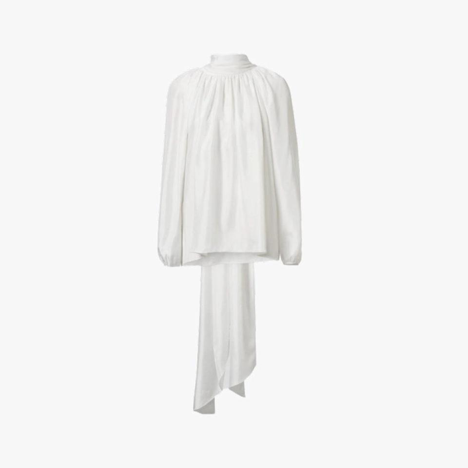 """Tove's flowy top is a seasonless wardrobe staple. $498, TOVE. <a href=""""https://tove-studio.com/collections/sale/products/rey-top-ivory"""" rel=""""nofollow noopener"""" target=""""_blank"""" data-ylk=""""slk:Get it now!"""" class=""""link rapid-noclick-resp"""">Get it now!</a>"""