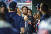 Atlanta Braves' Dansby Swanson, center, is congratulated in the dugout after scoring during the sixth inning of the team' baseball game against the Philadelphia Phillies, Wednesday, June 9, 2021, in Philadelphia. (AP Photo/Chris Szagola)