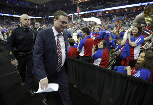 Kansas head coach Bill Self walks off the court following a regional semifinal game against Clemson in the NCAA men's college basketball tournament Friday, March 23, 2018, in Omaha, Neb. Kansas won 80-76. (AP Photo/Charlie Neibergall)