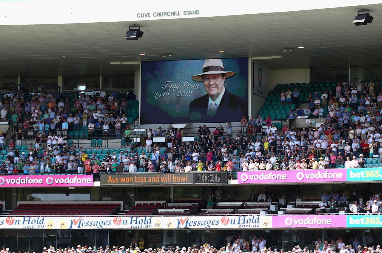 SYDNEY, AUSTRALIA - JANUARY 03:  The crowd stand to honour Tony Grieg who passed away last week during day one of the Third Test match between Australia and Sri Lanka at Sydney Cricket Ground on January 3, 2013 in Sydney, Australia.  (Photo by Ryan Pierse/Getty Images)