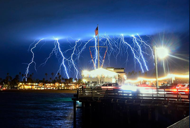 This time exposure photo provided by the Santa Barbara County Fire Department shows a series of lightning strikes over Santa Barbara, Calif., seen from Stearns Wharf in the city's harbor, Tuesday evening, March 5, 2019. A storm soaking California on Wednesday could trigger mudslides in wildfire burn areas where thousands of residents are under evacuation orders, authorities warned. (Photo: Mike Eliason/Santa Barbara County Fire Department via AP)