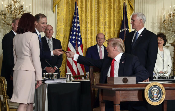 President Trump hands a pen to Jim Bridenstine, third from left, after signing a space policy directive, June 18, 2018. (Photo: Susan Walsh/AP)