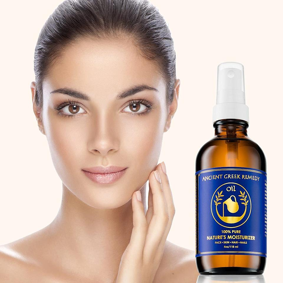"""Instead of using a million products to hydrate your complexion, this multipurpose oil blend will help lock in moisture and keep irritation at bay. You can also use it on your hair to help tame frizziness.<br /><br /><strong>Promising review:</strong>""""I brought initially on a whim because I was tired of buying the oils I needed separately and wanted to try something new. I WAS NOT DISAPPOINTED. I have kinky, curly and dry hair and I dye/bleach it often. I use this for moisture and my hair loves it. I also add it to hair masks or a pre-poo. For my skin, I mix this with my lotion and my shea butter.<strong>My skin is moisturized all day and thriving. I also use it on my feet in the winter when I go to sleep and it helps a ton with cracked heels.</strong>For my face, one pump does more than enough. If my hands are damp, I can use one pump for my face and my neck. This is now a staple in my skincare routine.<strong>I've stopped having breakouts, my skin is glowing and thriving and my tone has evened up</strong>. My sister is also now hooked on this as its one of the only moisturizers that have helped with her acne, tone and doesn't bother her sensitive skin."""" —<a href=""""https://amzn.to/3tBvgr0"""" target=""""_blank"""" rel=""""nofollow noopener noreferrer"""" data-skimlinks-tracking=""""5909265"""" data-vars-affiliate=""""Amazon"""" data-vars-href=""""https://www.amazon.com/gp/customer-reviews/R3EVKE81IL86WF?tag=bfmelanie-20&ascsubtag=5909265%2C6%2C36%2Cmobile_web%2C0%2C0%2C16567500"""" data-vars-keywords=""""cleaning,fast fashion"""" data-vars-link-id=""""16567500"""" data-vars-price="""""""" data-vars-product-id=""""15964379"""" data-vars-retailers=""""Amazon"""">Lo</a><br /><br /><strong>Get it from Amazon for<a href=""""https://amzn.to/33uxfCX"""" target=""""_blank"""" rel=""""nofollow noopener noreferrer"""" data-skimlinks-tracking=""""5909265"""" data-vars-affiliate=""""Amazon"""" data-vars-asin=""""B01B12KCGC"""" data-vars-href=""""https://www.amazon.com/dp/B01B12KCGC?tag=bfmelanie-20&ascsubtag=5909265%2C6%2C36%2Cmobile_web%2C0%2C0%2C16567498"""" data-vars-keywords=""""c"""