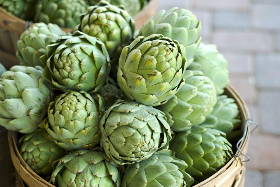 """<p>Believe it or not, <a href=""""https://www.prevention.com/food-nutrition/a20501605/how-to-cook-an-artichoke/"""" rel=""""nofollow noopener"""" target=""""_blank"""" data-ylk=""""slk:artichokes"""" class=""""link rapid-noclick-resp"""">artichokes</a> are loaded with antioxidants like polyphenols, which <a href=""""https://www.ncbi.nlm.nih.gov/pmc/articles/PMC4477242/"""" rel=""""nofollow noopener"""" target=""""_blank"""" data-ylk=""""slk:research suggests"""" class=""""link rapid-noclick-resp"""">research suggests </a>could play a valuable role in <a href=""""https://www.prevention.com/health/g20450767/how-to-prevent-breast-cancer/"""" rel=""""nofollow noopener"""" target=""""_blank"""" data-ylk=""""slk:breast cancer prevention"""" class=""""link rapid-noclick-resp"""">breast cancer prevention</a>. They're also one of the most fiber-packed veggies out there—a half cup of cooked artichoke hearts serves up 7 grams. And a <a href=""""https://jamanetwork.com/journals/jamaoncology/article-abstract/2753175"""" rel=""""nofollow noopener"""" target=""""_blank"""" data-ylk=""""slk:recent study"""" class=""""link rapid-noclick-resp"""">recent study</a> found that people who get the most fiber are 17% less likely to develop lung cancer compared to those who get the least.</p><p><strong>Try it:</strong> <a href=""""https://www.prevention.com/food-nutrition/a29933840/spinach-and-artichoke-pizza-recipe/"""" rel=""""nofollow noopener"""" target=""""_blank"""" data-ylk=""""slk:Healthy Spinach and Artichoke Pizza"""" class=""""link rapid-noclick-resp"""">Healthy Spinach and Artichoke Pizza</a></p>"""