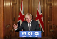 FILE - In this Wednesday Dec. 30, 2020 file photo, Britain's Prime Minister Boris Johnson speaks at a press conference in 10 Downing Street, London. Johnson has warned that more onerous lockdown restrictions in England are likely as the country reels from a new variant of the coronavirus that has seen infection rates soar to their highest recorded levels. The U.K. is in the midst of an acute outbreak, recording more than 50,000 new coronavirus infections a day over the past five days. (Heathcliff O'Malley/Pool via AP)