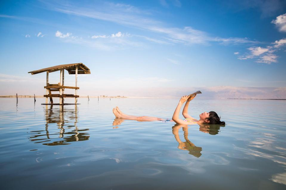 <p>The Dead Sea is the deepest landlocked salt lake in the world, and its extreme levels of saline means it cannot sustain animal life - hence the name. Because of the high density of the water, swimming in the lake is more like floating on the top of the water. </p>