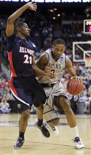Georgetown's Greg Whittington, right, drives to the basket against Belmont's Ian Clark during the second half of an NCAA college basketball tournament second-round game on Friday, March 16, 2012, in Columbus, Ohio. Georgetown defeated Belmont 74-59. (AP Photo/Jay LaPrete)