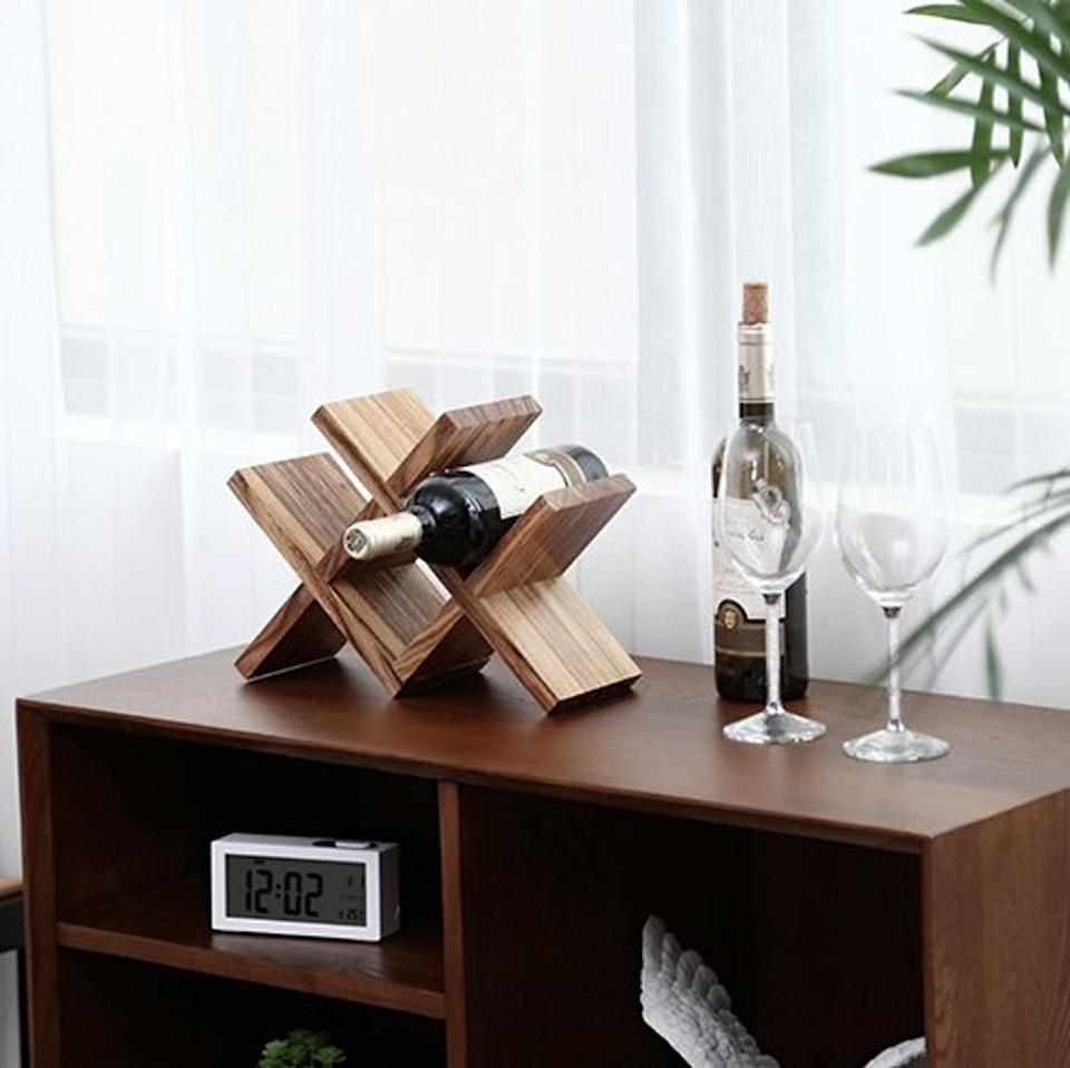 <p>Give them an elegant place to display their wine bottles with this <span>Wooden Wine Rack</span> ($86). We like the simple construction and compartmentalized look.</p>