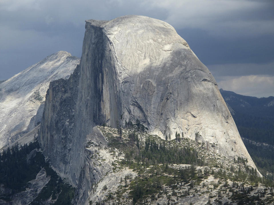 FILE - This August 2011 file photo shows Half Dome and Yosemite Valley in a view from Glacier Point at Yosemite National Park, Calif. The quest to climb El Capitan and the famous big walls of Yosemite National Park just got a bit harder. Yosemite National Park added some red tape on Friday, May 7, 2021, for climbers to cut through before they can begin the physically grueling, mentally demanding feat that takes several days as they inch up the vertical granite wall and sleep at night suspended on tiny platforms thousands of feet above Yosemite Valley. (AP Photo/Tracie Cone, File)