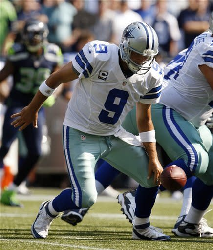 Dallas Cowboys quarterback Tony Romo (9) reaches for a bobbled snap against the Seattle Seahawks in the first half of an NFL football game on Sunday, Sept. 16, 2012, in Seattle. Romo recovered the ball. (AP Photo/Kevin P. Casey)