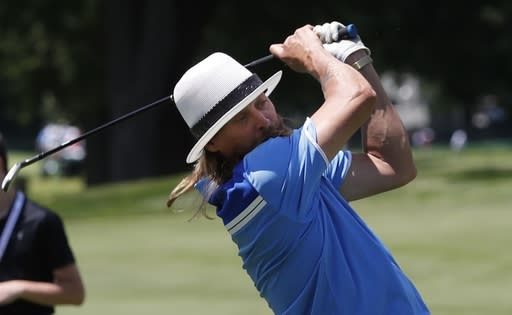 Kid Rock hits from the 18th fairway during the Pro-AM for the Rocket Mortgage Classic golf tournament, Wednesday, June 26, 2019, in Detroit. (AP Photo/Carlos Osorio)
