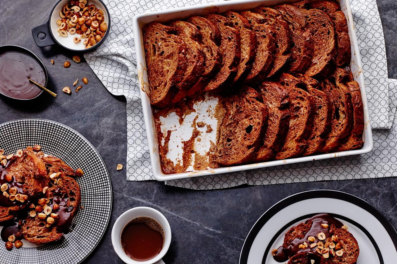 """With a dense custardy inside, a crispy crust, and an extra dose of hot chocolate sauce to pour over the top, this is the most indulgent, decadent breakfast you can prep in advance for Christmas morning. <a href=""""https://www.epicurious.com/recipes/food/views/hot-chocolate-baked-french-toast?mbid=synd_yahoo_rss"""">See recipe.</a>"""