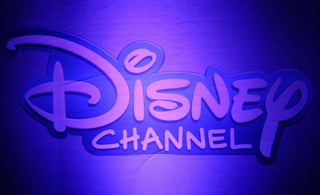 Disney Channel logo hangs on the wall during a press conference for the TV channel in 2013 (Angelika Warmuth/picture alliance via Getty Images)