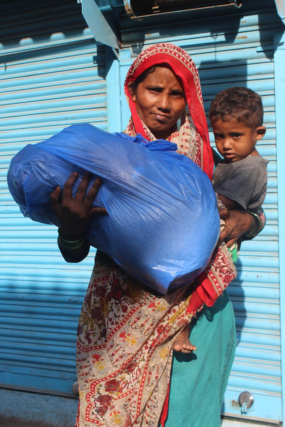 A mother and son with relief kit distributed by Feeding From Far