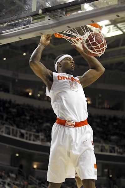 Syracuse forward C.J. Fair (5) ducks the ball against California during the first half of a third-round game in the NCAA college basketball tournament Saturday, March 23, 2013, in San Jose, Calif. (AP Photo/Tony Avelar)