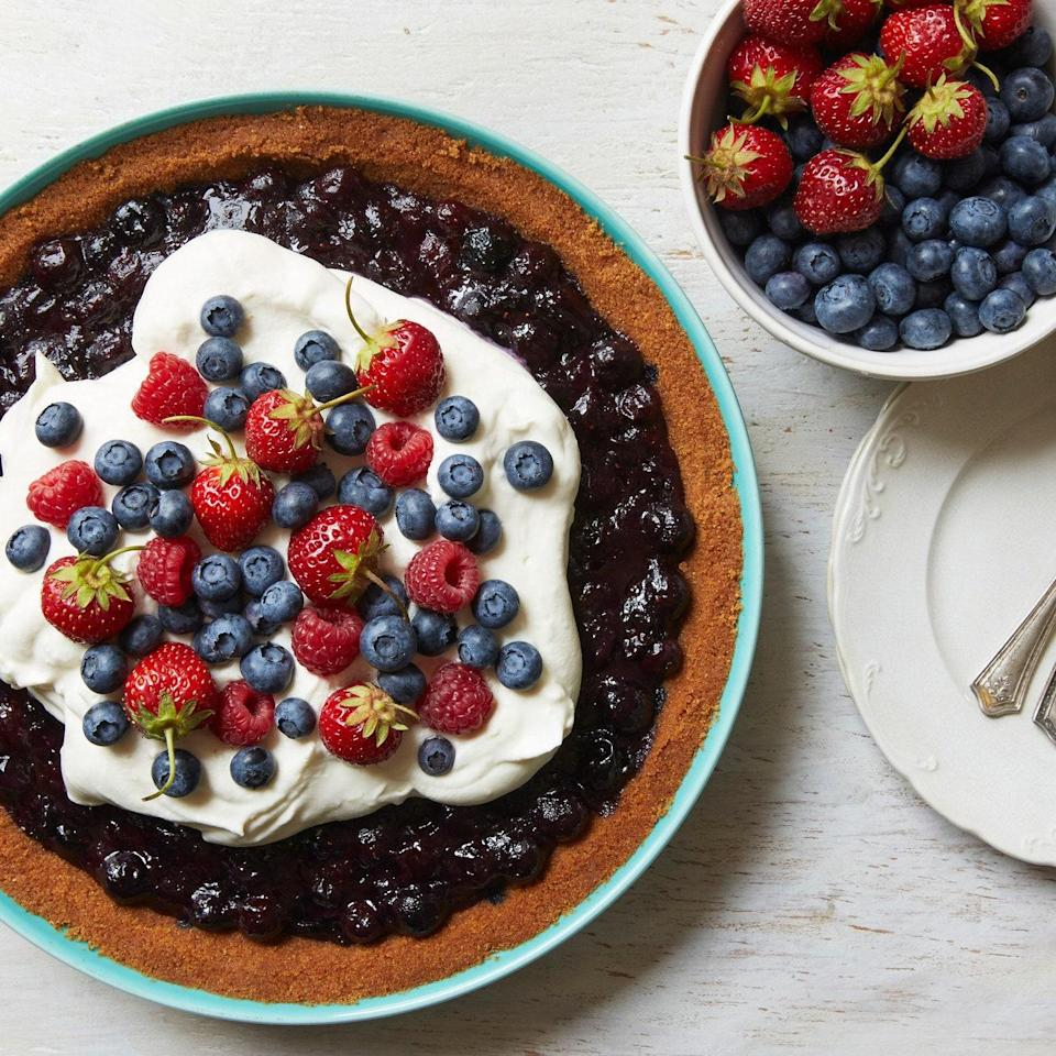"A pile of red and blue berries tops off a cloud of white whipped cream in this easy (and festive) pie. <a href=""https://www.epicurious.com/recipes/food/views/red-white-and-blueberry-pie-51241610?mbid=synd_yahoo_rss"" rel=""nofollow noopener"" target=""_blank"" data-ylk=""slk:See recipe."" class=""link rapid-noclick-resp"">See recipe.</a>"