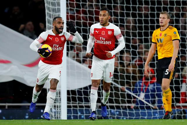 """Soccer Football - Premier League - Arsenal v Wolverhampton Wanderers - Emirates Stadium, London, Britain - November 11, 2018 Arsenal's Alexandre Lacazette and Pierre-Emerick Aubameyang celebrate their first goal REUTERS/Eddie Keogh EDITORIAL USE ONLY. No use with unauthorized audio, video, data, fixture lists, club/league logos or """"live"""" services. Online in-match use limited to 75 images, no video emulation. No use in betting, games or single club/league/player publications. Please contact your account representative for further details."""