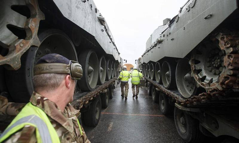 British military vehicles are unloaded at the Paldiski port in Estonia as part of a Nato plan to deter Russia.