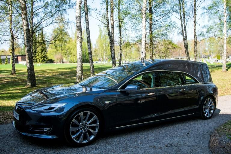 """Many people drive an electric car in Norway and some want to leave this planet in a green way,"" says undertaker Odd Borgar Jolstad, demonstrating his Tesla hearse in the tranquil Grefsen cemetery overlooking the capital (AFP Photo/Jonathan NACKSTRAND)"