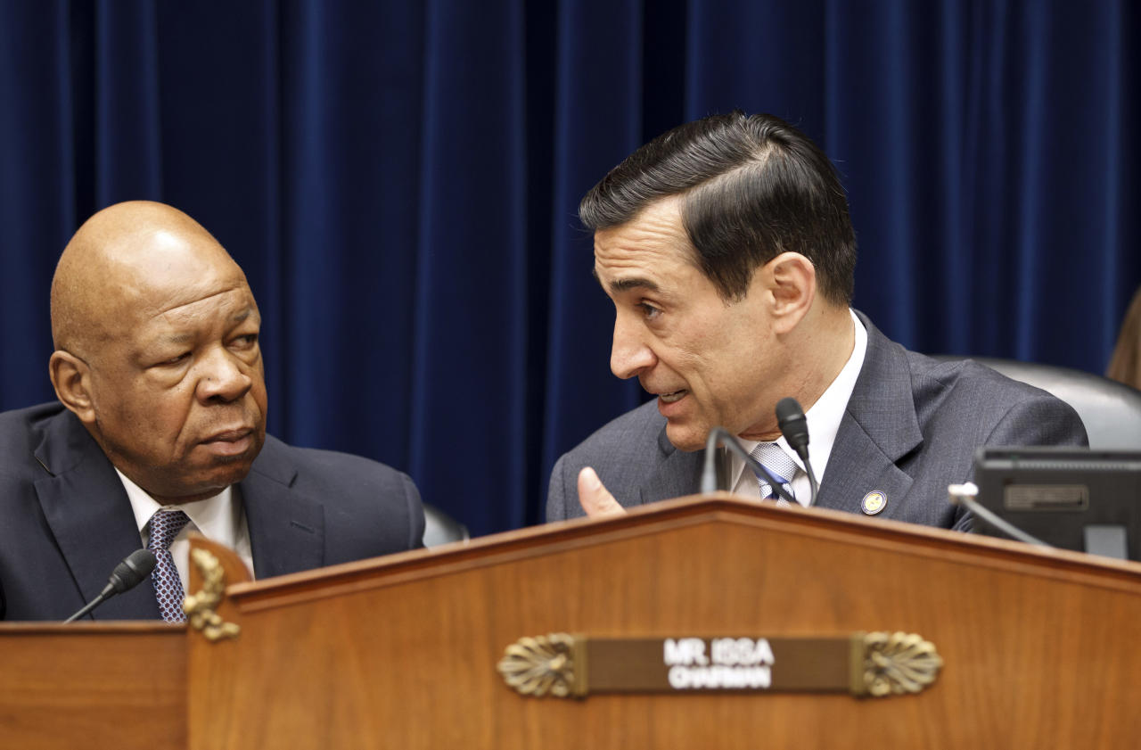 House Oversight and Government Reform Committee Chairman Rep. Darrell Issa, D-Calif., right, talks with the Committee's ranking Democrat, Rep. Elijah Cummings, D-Md., on Capitol Hill in Washington, Monday, April 16, 2012, during the committee's hearing investigating wasteful spending by the General Services Administration. (AP Photo/J. Scott Applewhite)