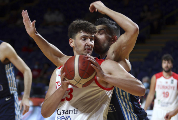 FILE - In this July 3, 2021, file photo, Turkey's Alperen Sengun looks for an opening as Greece's Konstantinos Mitoglou defends during the first half of a semifinal in the FIBA men's Olympic basketball qualifying tournament in Victoria, British Columbia. Sengun was selected by the Oklahoma City Thunder in the NBA draft. (Chad Hipolito/The Canadian Press via AP)