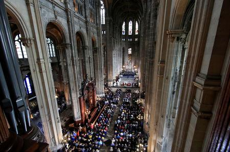 People attend Easter Sunday Mass at Saint-Eustache, days after a massive fire devastated large parts of the structure of the gothic Notre-Dame Cathedral, in Paris, France, April 21, 2019.  REUTERS/Gonzalo Fuentes