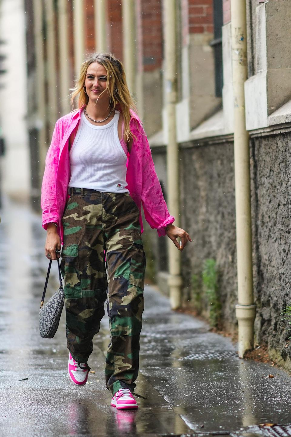 <p>Contrast the utilitarian vibes of camo print cargos with bright pink accents. </p>