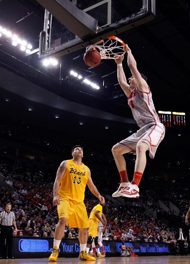 PORTLAND, OR - MARCH 15: Cameron Bairstow #41 of the New Mexico Lobos dunks the ball as Edis Dervisevic #13 of the Long Beach State 49ers looks on in the first half in the second round of the 2012 NCAA men's basketball tournament at Rose Garden Arena on March 15, 2012 in Portland, Oregon. (Photo by Jonathan Ferrey/Getty Images)