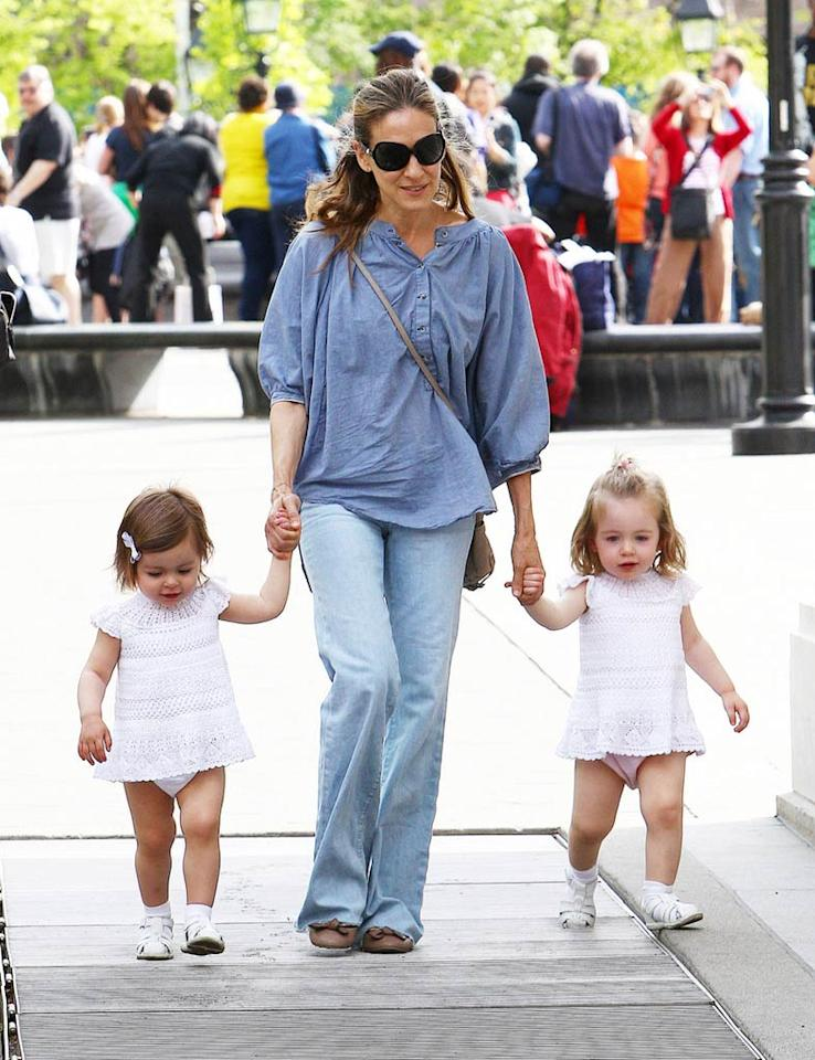 """Sarah Jessica Parker got a double dose of Mother's Day celebrating it with cutie-pie twins Marion and Tabitha, who turn 2 next month. The threesome walked around New York's Washington Square Park and stopped to take in some street performances. Wagner Az/<a href=""""http://www.pacificcoastnews.com/"""" target=""""new"""">PacificCoastNews.com</a> - May 8, 2011"""