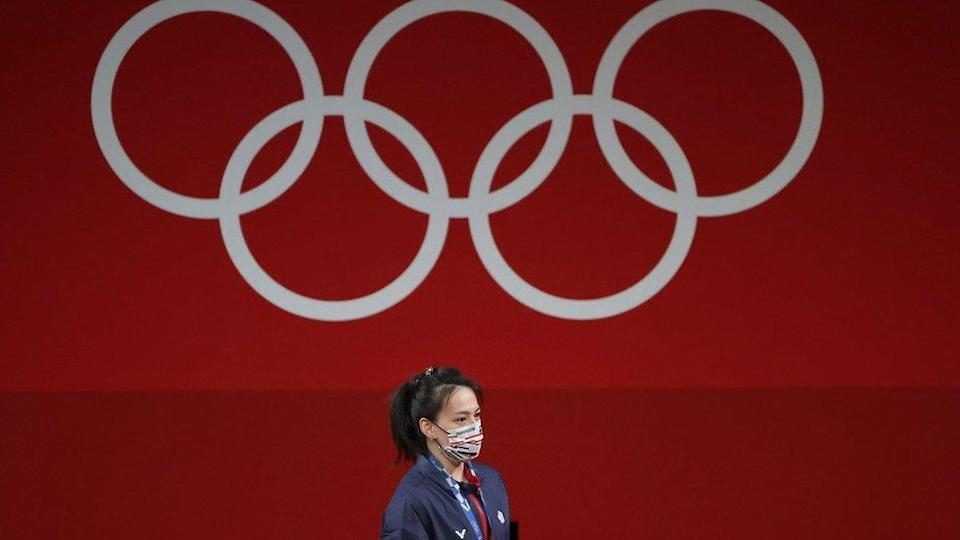 Golden medalist Hsing-Chun Kuo of Chinese Taipei at the podium after the Women