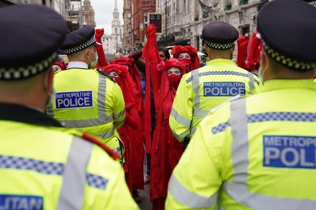 Red Rebels gather during a protest by members of Extinction Rebellion