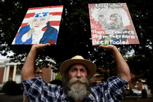 "<p>Daniel Gray, an artist from Crozet, Virginia, holds his paintings before ""Charlottesville to D.C: The March to Confront White Supremacy,"" a ten-day trek to the nation's capital from Charlottesville, Va., Aug. 28, 2017. (Photo: Sait Serkan Gurbuz/Reuters) </p>"