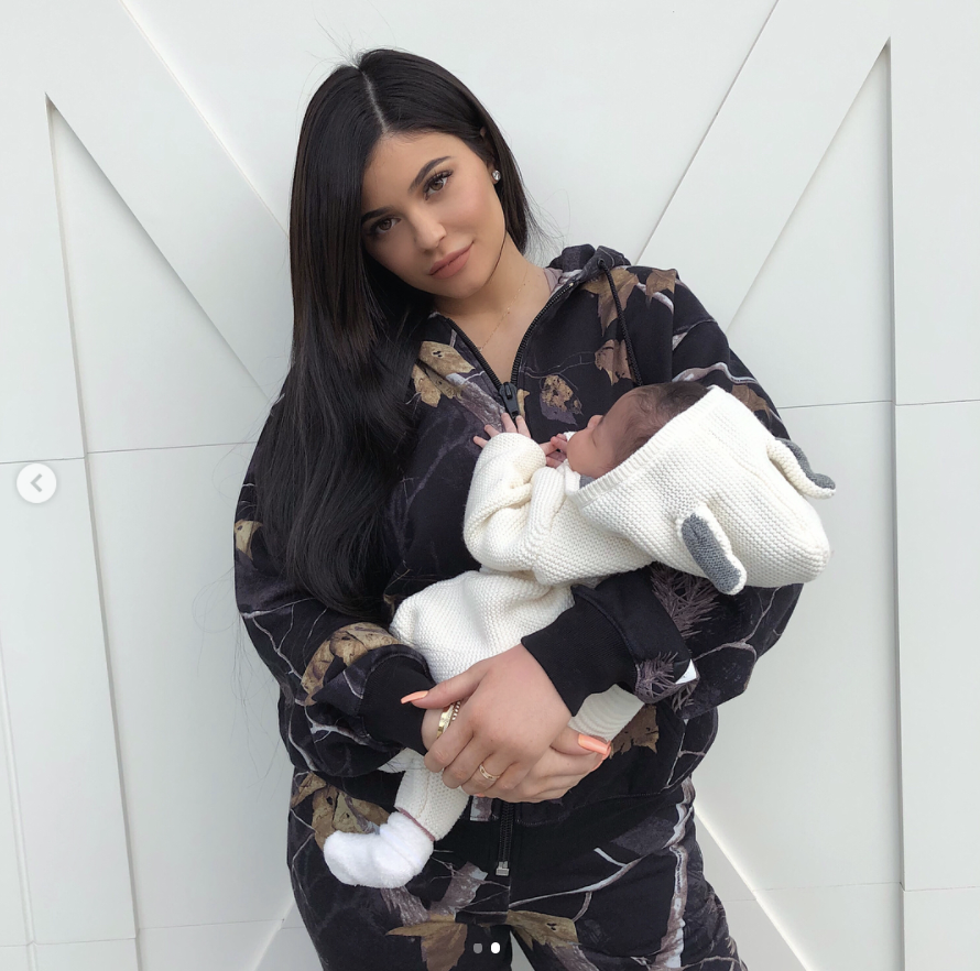 "<p>""My angel baby is 1 month old today,"" the beauty mogul captured this milestone with a snap of little Stormi bundled in her arms. The little girl's dad, Travis Scott, also made his own dedication to the newest love of his life. He posted a close-up pic of his daughter wearing a sweater that said ""DADDY"" in a red heart. (Photo: <a rel=""nofollow"" href=""https://www.instagram.com/p/BfzEfy-lK1N/?taken-by=kyliejenner"">Kylie Jenner via Instagram</a>) </p>"